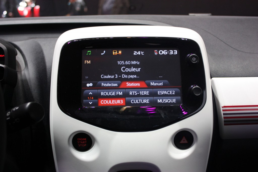 Peugeot, Citroen and Toyota have showcased their own take on CarPlay with a touch-screen system that mirrors a user's smartphone apps.